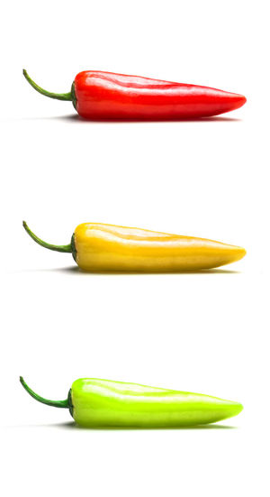 Close-up of Red, yellow and green hot peppers vertically among each other isolated on white background. Pepper Three Objects Yellow Group Of Objects Cut Out No People Close-up Still Life Spice Indoors  Food And Drink Red Freshness Healthy Eating Green Chili Pepper Wellbeing Studio Shot Isolated White Background Spicy Spices Healthy Food Raw Raw Food Vegetable Pepperoni Peppers Pepper - Vegetable Indoors  Green Color
