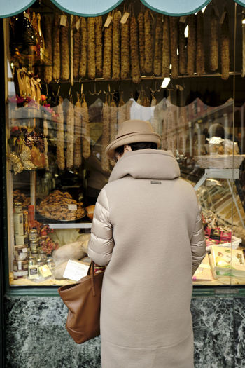 Piacenza, Italy - December 2018 Piacenza Italy Salumi Woman Choice Food And Drink One Person Store Real People Food Adult Retail  Variation Retail Display Standing For Sale Rear View Shopping Business Women Lifestyles Market Three Quarter Length My Best Photo Springtime Decadence
