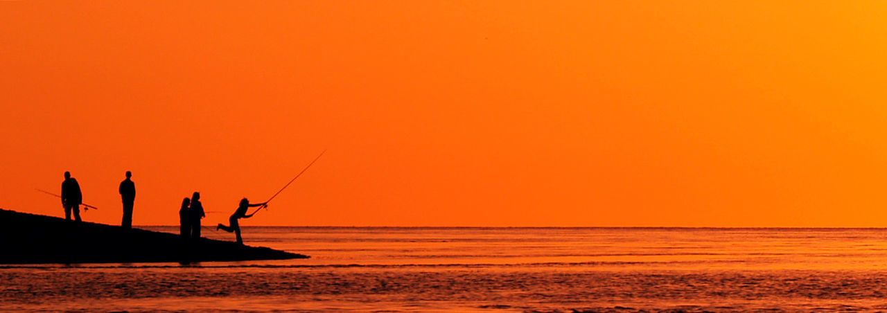 Fishing on the sun Adult Beach Beauty In Nature Fisherman Fishing Horizon Over Water Leisure Activity Lifestyles Men Nature Orange Color Outdoors Real People Scenics Sea Silhouette Sky Standing Sunset Togetherness Tranquil Scene Tranquility Two People Vacations Water