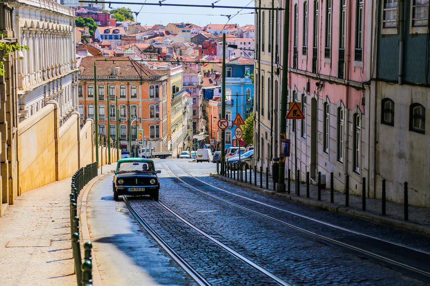 Architecture Building Building Exterior Built Structure Car City City Life City Street Colorful Composition Hill Incidental People Land Vehicle Leading Lisbon Mode Of Transport Narrow Perspective Portugal Street The Way Forward Tram Transportation Travel Urban