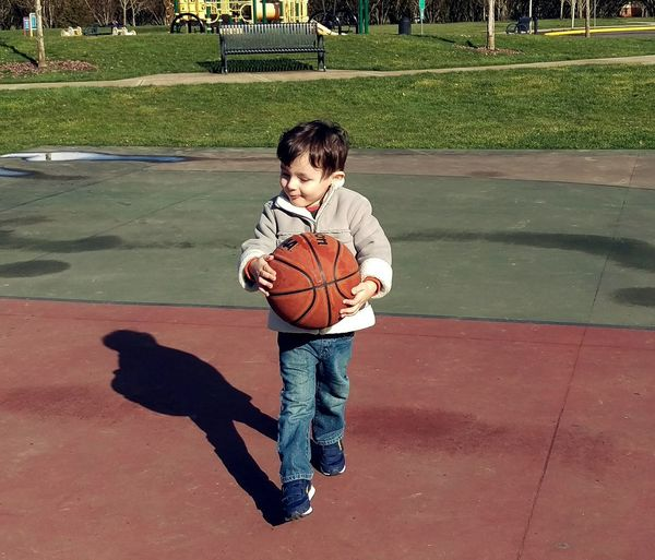 Sport Child Court Boys Full Length Childhood Tennis Ball Outdoors Playing Children Only One Boy Only One Person People
