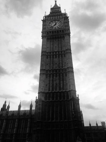 Tower Travel Destinations Architecture Sky Low Angle View Built Structure Tall - High Cloud - Sky Clock Tourism Travel Clock Tower City Building Exterior Outdoors Day Time Cultures No People EyeEm Best Shots EyeEm Gallery IPhoneography Blackandwhite Big Ben City Welcome To Black