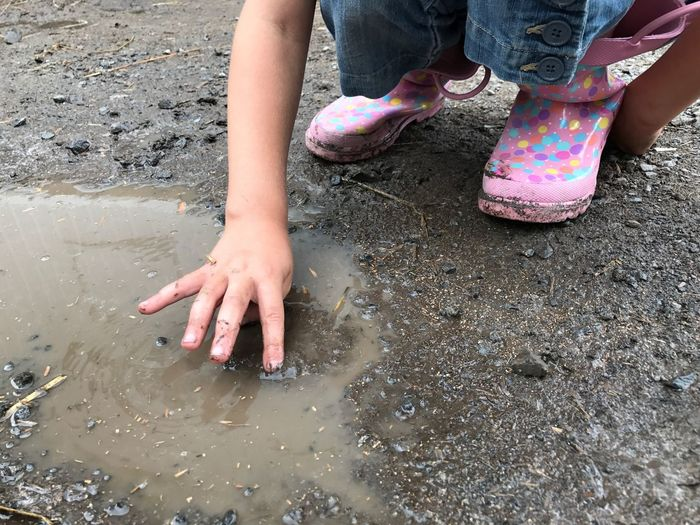 Summer fun, kids love water and mud, mud boots, dirty, playing