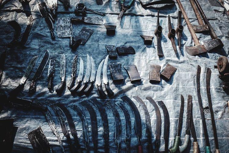 Full frame shot of knives on table