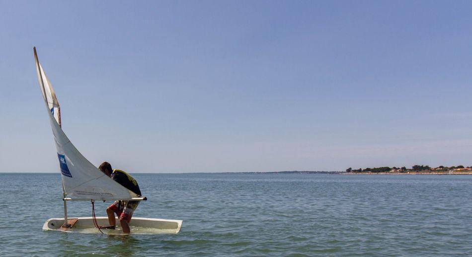 Beach Boat Horizon Over Water Men Nautical Vessel Outdoors Sea Sinking Sky Water