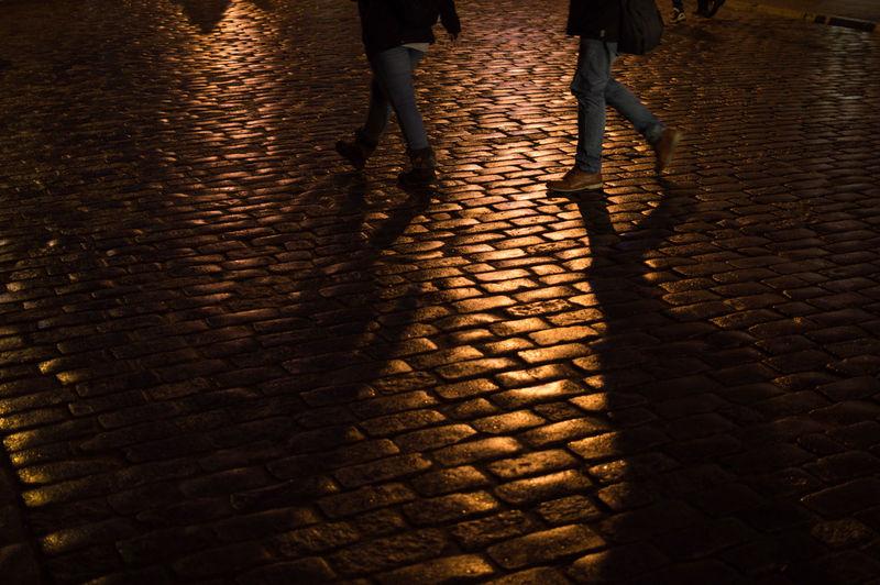 Poland Warsaw Europe Low Section Human Leg Street Real People Lifestyles Walking City Night Standing People Cobblestone Human Body Part Body Part Shoe Shadow Women Two People Footpath Adult Illuminated Outdoors Human Limb Brick Paving Stone Nightlife