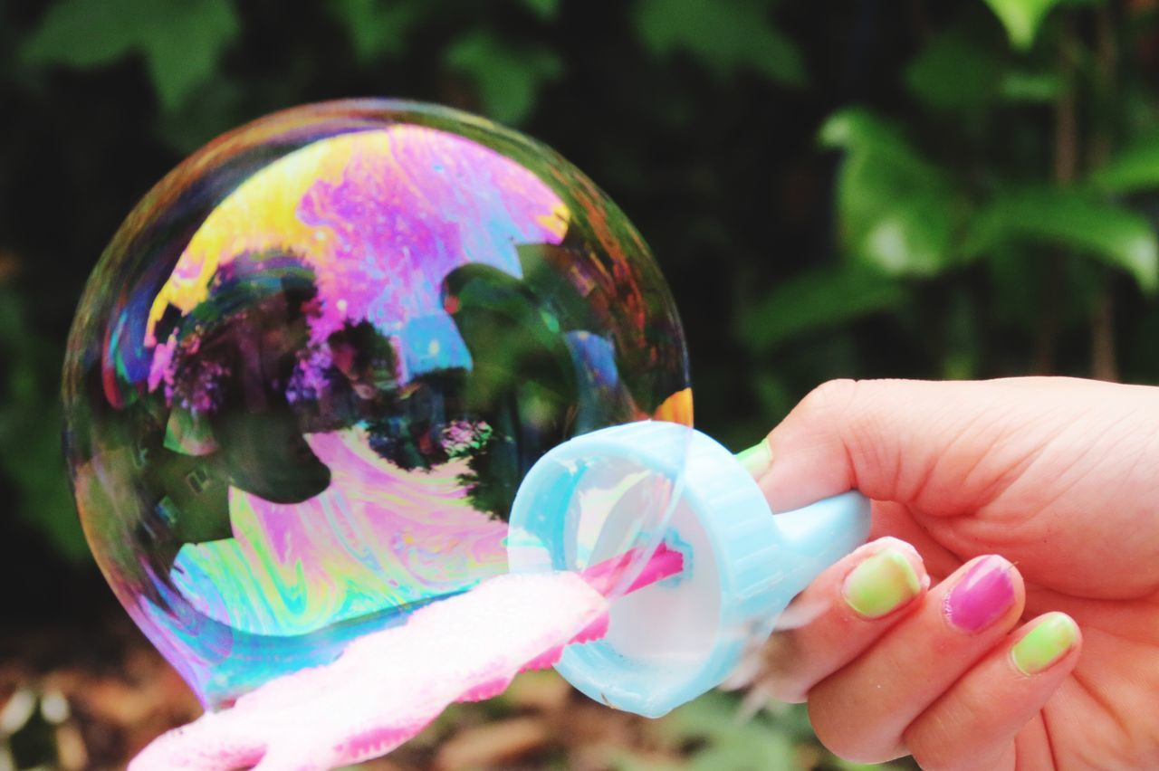 Cropped Hand Of Woman Holding Bubble Wand