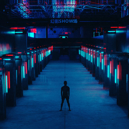 Man standing in illuminated room