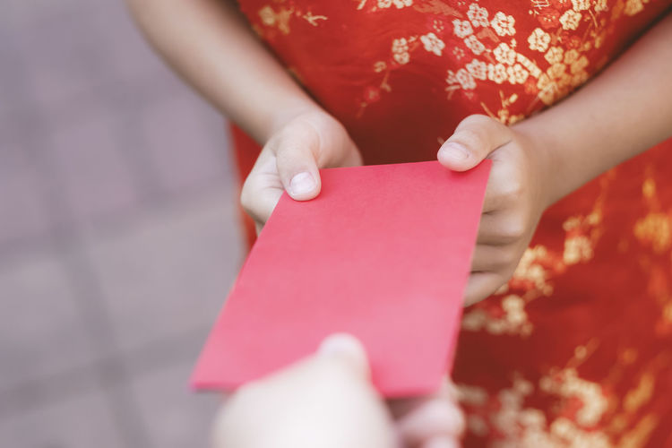 Close-up of woman holding red hands