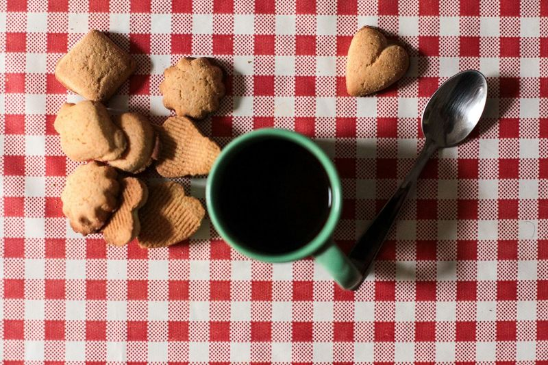 Directly Above View Of Cookies And Black Coffee On Table