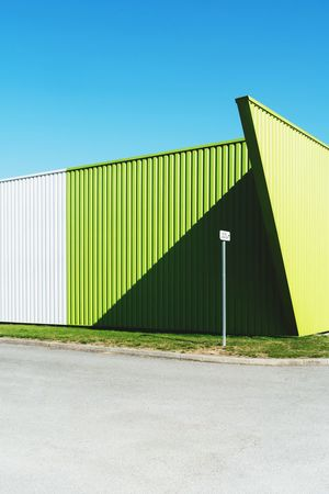 Stripes Lines And Shapes Lines Wall Green Deserted Business Warehouse District Built Structure Architecture Sky Clear Sky Green Color Sunlight Nature Building Exterior Blue Copy Space Wall - Building Feature Corrugated Iron Shadow Metal Sunny Day