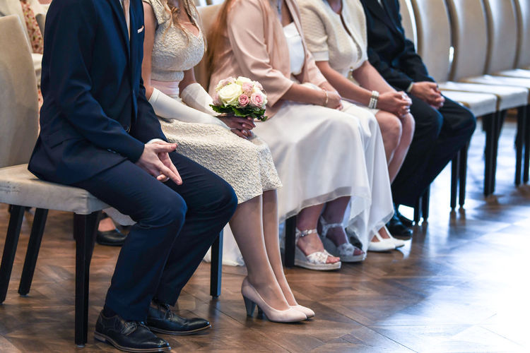 Women Real People Group Of People Adult Sitting Seat Men Low Section Lifestyles Flower Event Clothing People Indoors  Wedding Medium Group Of People Flowering Plant Leisure Activity Celebration Shoe Wedding Ceremony Bouquet Wedding