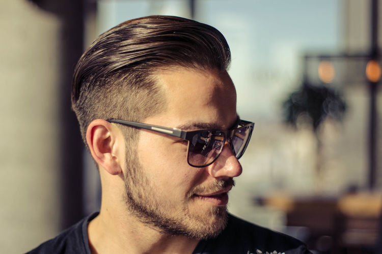 Beard Body Part Close-up Contemplation Eyeglasses  Facial Hair Fashion Focus On Foreground Front View Glasses Headshot Human Face Indoors  Lifestyles Men One Person Portrait Real People Sunglasses Young Adult Young Men