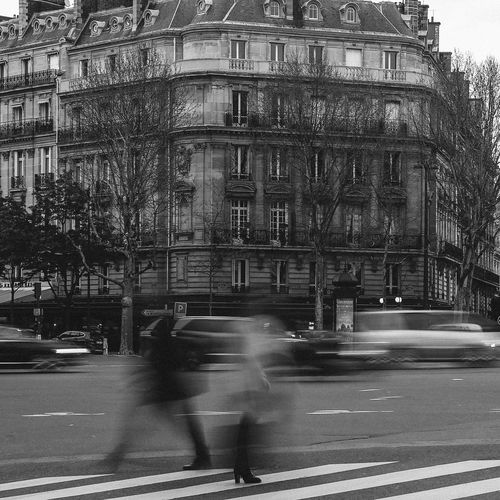 Blurred motion of road and buildings in city
