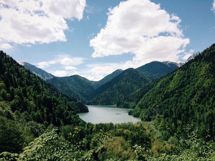 Scenic View Of Lake Amidst Tree Mountains Against Sky