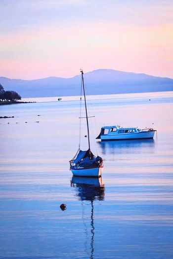 Beautiful peach-violet sunset Nautical Vessel Transportation Beauty In Nature Tranquility Water Reflection Outdoors Sunset Sea No People Amateurphotography Scenic Landscapes New Zealand Boat Boats And Sea Boats And Water Purple Peach Peaches Purple Sunset Pink Pink Sunset Mountain Millennial Pink