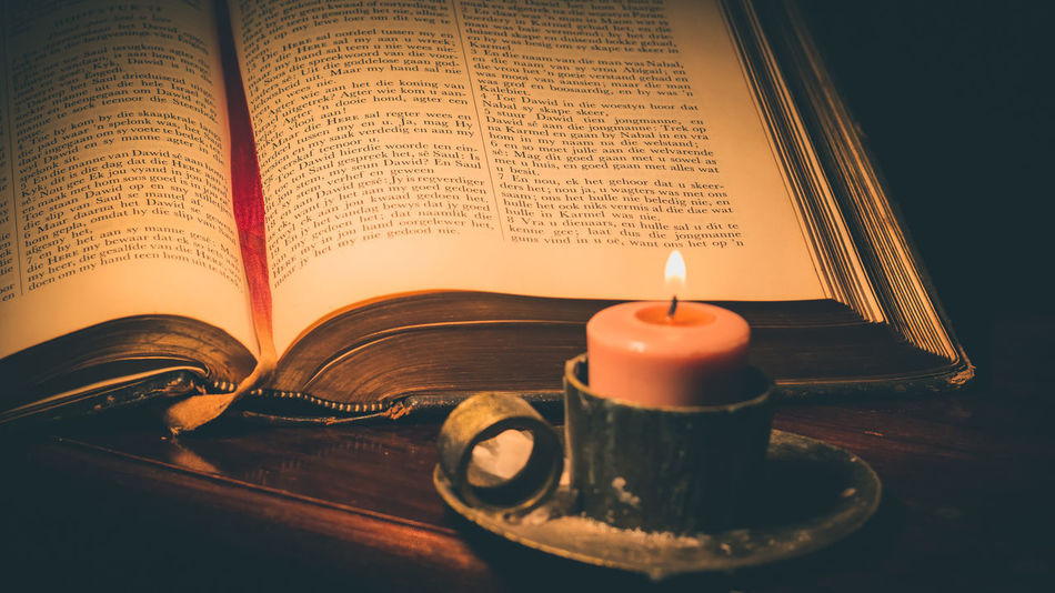 Afrikaans Bible Book Candle Close-up Education Flame Indoors  Literature No People Open Page Relegion Spirituality Table Wisdom