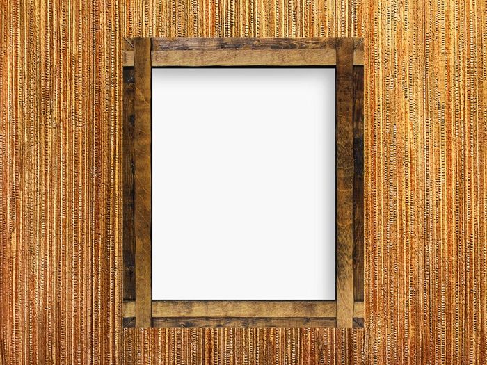 Close-up of empty picture frame on table