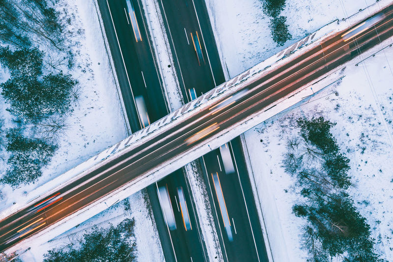Road Drone  Aerial View Aerial Mavic 2 Mavic 2 Pro DJI X Eyeem Aerial Photography Road Winter Snow Snowing Built Structure Glass - Material Architecture Window Building Exterior No People Day Nature Reflection Tree Transparent Tilt Low Angle View Outdoors Plant Building City Sky Transportation 17.62°