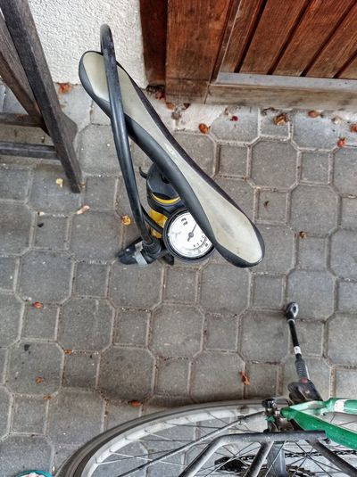 High angle view of bicycle on footpath at home