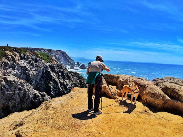 Camera & tripod. Whale watching. Man and dog. Man Dog Tan Golden Camera Equipment Tripod Shadow Dog Lease Looking Up Adoring Ocean Sandstone Overlook Background Whale Watching Minimalism Cap Casual Clothing Distance Water Full Length Sea Beach Standing Sunlight Sand Motion Shadow The Mobile Photographer - 2019 EyeEm Awards The Great Outdoors - 2019 EyeEm Awards The Traveler - 2019 EyeEm Awards