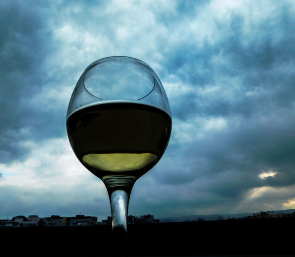 Alone Drinks EyeEmNewHere Lonely Alcohol Close-up Cloud - Sky Day Depression Drink Drinking Drinking Glass Half Glass Full No People Outdoors Party Sky White Wine Wine Wineglass