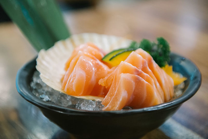 Fresh salmon slice or salmon sashimi Japanese style food. Background Beautiful Bright Closeup Cooking Cuisine Culture Delicious Dinner Eating Fat Fish Food Fresh Freshness Gourmet Green Health Healthy Ice Ingredient Japan Japanese  Leaf LINE Market Meal Meat Natural Nature Orange People Piece Prepared Raw Restaurant Salmon Sashimi  Seafood Set SLICE Style Sushi Tasty Texture Traditional Wasabi White Food And Drink Healthy Eating