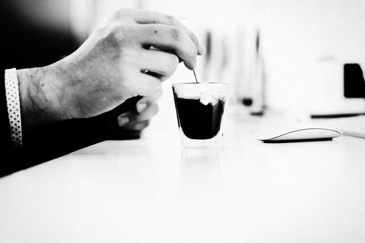 Hand Of Man Holding Spoon Stirring Coffee