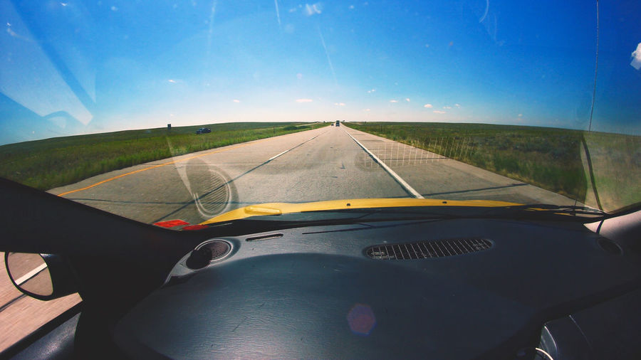Halfway point in a cross country road trip, somewhere in Colorado. Bright Car Colorado Dodge Neon Fields Of Gold Get Inspired Good Vibes Interior Landscape_photography Landscapes Reflection Road Roadtrip Sunny Day Travel Vibrant Wanderlust