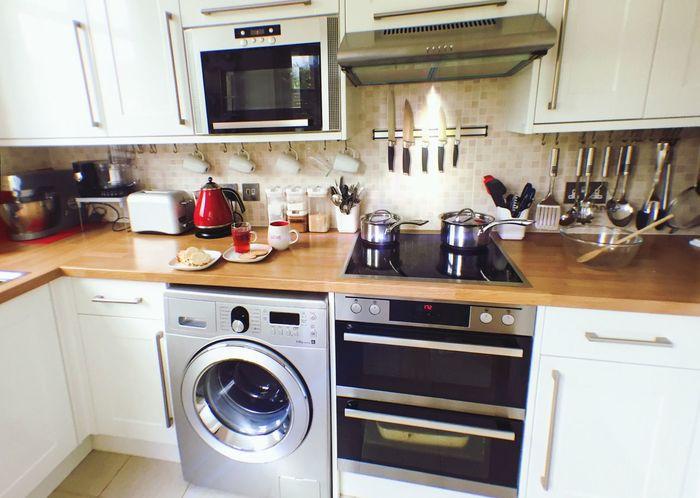 A small space saving kitchen Organised Space Saver Kitchen Kitchenware Kitchenwares White Red Countertop Wooden Appliances Kitchen Appliances Decor Home Interior Interiors Design Interior Design Design Architecture