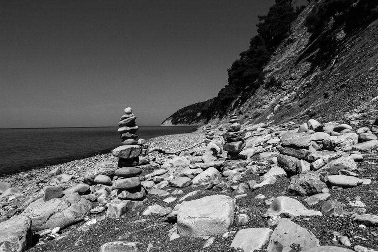 Rest on the Black Sea coast. Rock sail. Geological monument. Rock Water Solid Sea Rock - Object Sky Beauty In Nature Beach Nature Horizon Over Water Land Horizon Day Clear Sky Scenics - Nature Tranquility Tranquil Scene Non-urban Scene People Outdoors Pebble Black Sea Geology Summer Blackandwhite