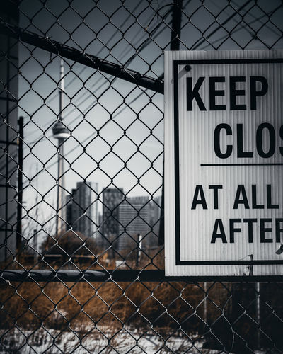 Restrained EyeEm Best Shots EyeEmNewHere EyeEm Nature Lover EyeEm Selects EyeEm Gallery Nikon D750 Concept Conceptual Focus On Background Sharp Dark Photography Moon Surface Tripod Toronto Ontario Canada Canadian Best  Fresh New Text Western Script Sign Communication Fence Safety Security Boundary Protection Barrier No People Information Chainlink Fence Warning Sign Day Metal Information Sign Capital Letter Outdoors Built Structure Message