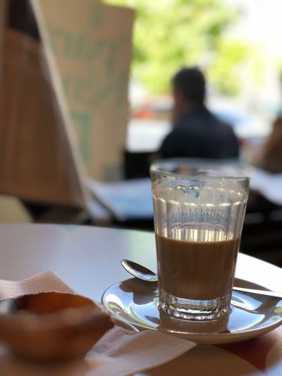 Close-up of coffee served on table at cafe