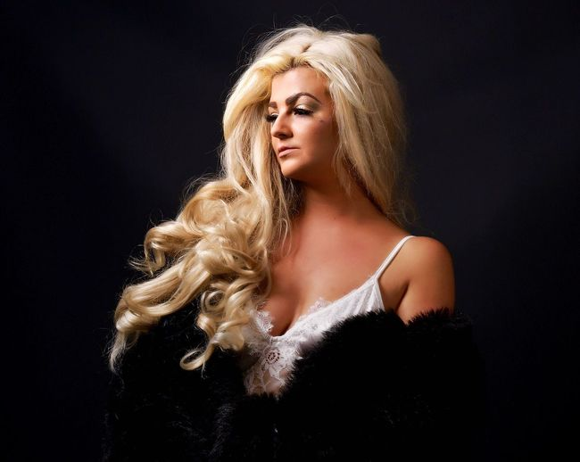 One Person Studio Shot Beauty Blond Hair Portrait Women Hair Young Adult Black Background Hairstyle Indoors  Beautiful Woman Young Women Headshot Long Hair Fashion Beautiful People Teenager Human Face