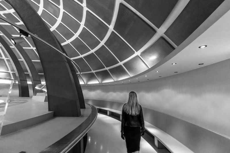 GroundControl EyeEmNewHere SpaceShip Real People Escalator Rear View Lifestyles One Person Leisure Activity Indoors  Architecture Built Structure Modern Women Illuminated Day Men Full Length People Black And White Friday