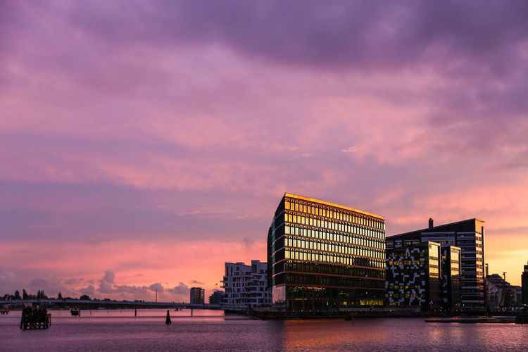 Architecture Building Exterior Built Structure City Cloud - Sky Colorful Sky Day Modern Nature No People Outdoors Purple Sea Sky Sunset Water Waterfront