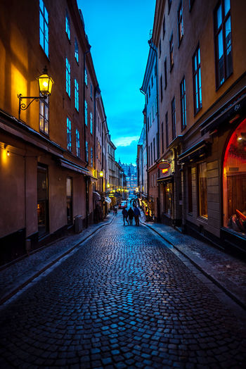 Gamla Stan, the old town of Stockholm Gamla Stan Stockholm Old Town Perspectives Stockholm, Sweden Architecture Building Building Exterior Built Structure City Cobblestone Direction Dusk Dusk In The City Footpath Illuminated Incidental People Lifestyles Nature Outdoors Paving Stone Real People Residential District Street The Way Forward Walking