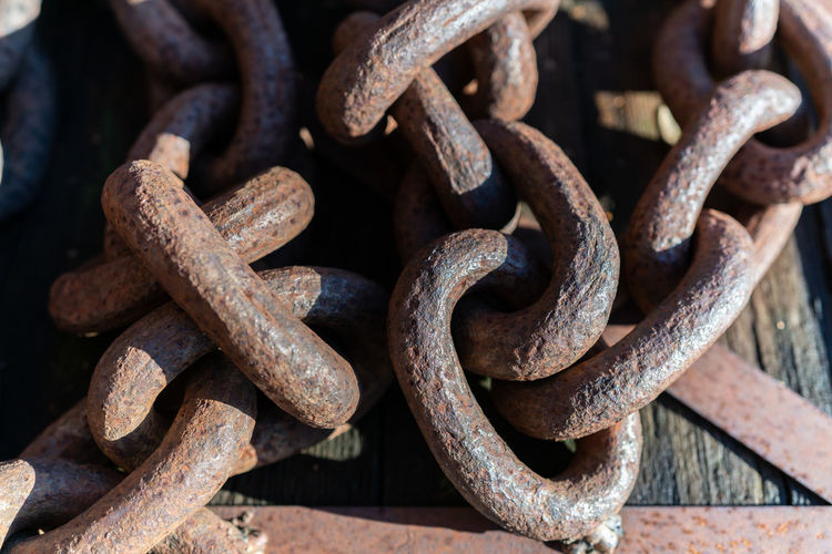 Close-up of rusty chains outdoors