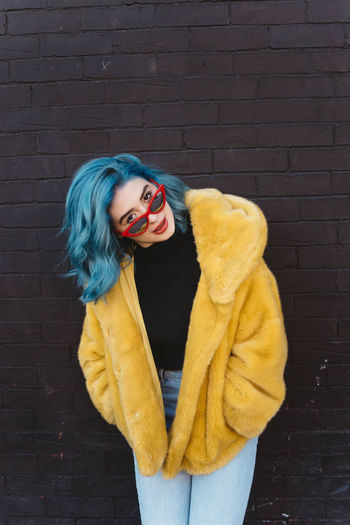 Women Portrait Yellow Clothing Adult Looking At Camera Beautiful Woman Standing Real People Young Women Lifestyles One Person Young Adult Wall - Building Feature Beauty Leisure Activity Fashion Warm Clothing Brick Wall Hair Hairstyle Scarf City Urban
