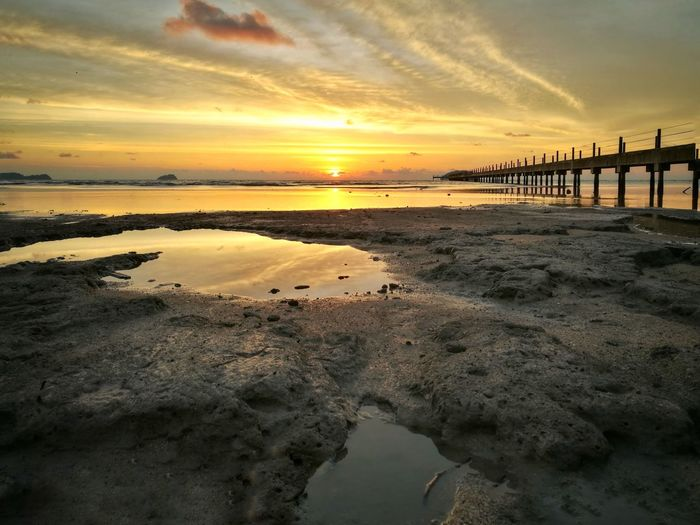 Sunset in Pantai Murni Sunset Reflection Water Sea Beach Beauty In Nature Sky Nature Outdoors Scenics No People Horizon Over Water HuaweiP9 Malaysianphotographer Malaysia Mobilephotography PhonePhotography Huawei Leicadualcamera Landscape Mobile Photography Pier