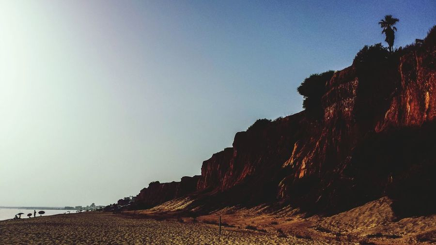 The Traveler - 2015 EyeEm Awards Beach Atlantic Ocean Atlantic Ocean Cliffs Portugese Outdoors Europe Southern Europe Evening Sunset Sunshine Landscape Shade Shadow Algarve Miles Away Lost In The Landscape