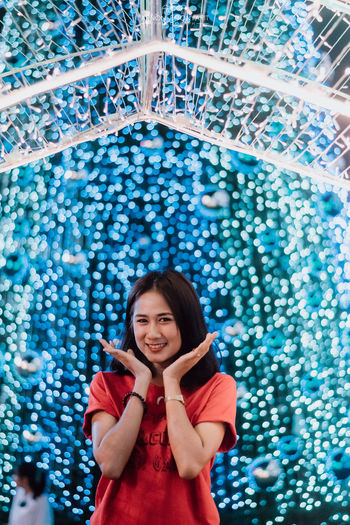 Merry Christmas. Christmas Christmas Lights Christmas Decoration Christmas Ornament Christmas Themes One Person Front View Portrait Indoors  Standing Real People Looking At Camera Smiling Young Adult Women Waist Up Young Women Leisure Activity Casual Clothing Hairstyle Lifestyles Happiness Pattern Beautiful Woman