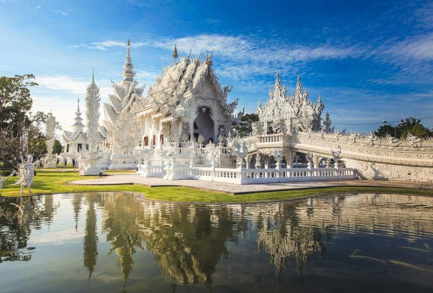 WatRongKhunWhiteTemple Chaingrai Reflection Water Architecture Built Structure Building Exterior Sky Travel Destinations Tourism Government Tree Politics And Government Outdoors No People Day