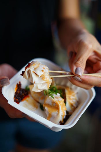 Dumplings, anyone? Dumplings Food Human Hand Food And Drink Hand Human Body Part Holding Ready-to-eat One Person Freshness Eating Utensil Spoon Kitchen Utensil Chopsticks Healthy Eating Plate Close-up Asian Food Indulgence Meal Snack Chinese Food
