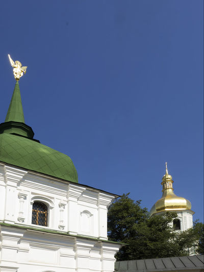 Archangel Michael in St. Sophia monastery, Kiev, Ukraine Gold Michael Monastery Archangel Architecture Blue Building Exterior Built Structure Clear Sky Day Dome Low Angle View No People Outdoors Place Of Worship Religion Saint Sculpture Sky Spirituality St Sophie Statue Tree