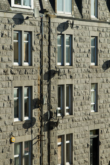 Tenement windows Apartments Or Flats Architecture Building Exterior Built Structure City Living Day Full Frame Granite No People Outdoors Residential Building Satellite Dishes Tenement Houses Window