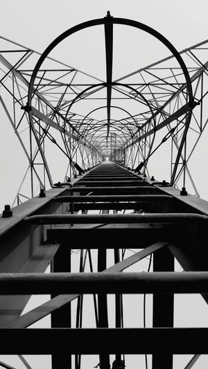 Low angle view of bridge against sky in city