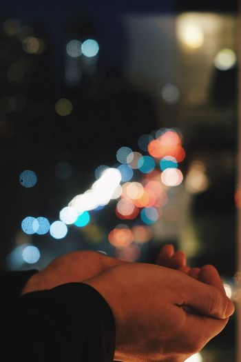 Catching all the light Bokehlicious Bokeh Photography Bokeh City Lights Colorful Lights In The Dark Lights Night Photography Night Lights Nightphotography One Person Real People Human Body Part Hand Human Hand Lifestyles Multi Colored Illuminated Focus On Foreground Personal Perspective Night Leisure Activity Indoors  A New Perspective On Life Capture Tomorrow Humanity Meets Technology