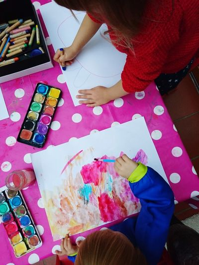 High angle view of child painting on table