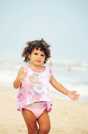Cute Girl Standing At Beach